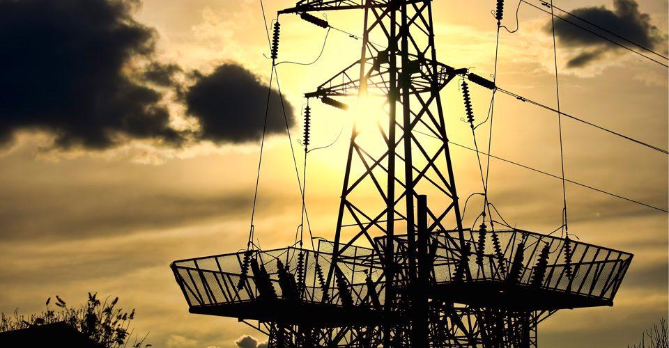 electrical tower yellow sky A\J AlternativesJournal.ca