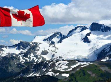 Canadian flag, snowy mountains. A\J AlternativesJournal.ca