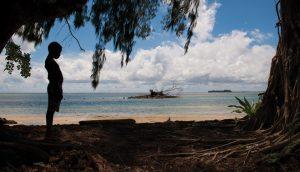 Silhouette of a boy on a beach in Papua New Guinea. A\J AlternativesJournal.ca