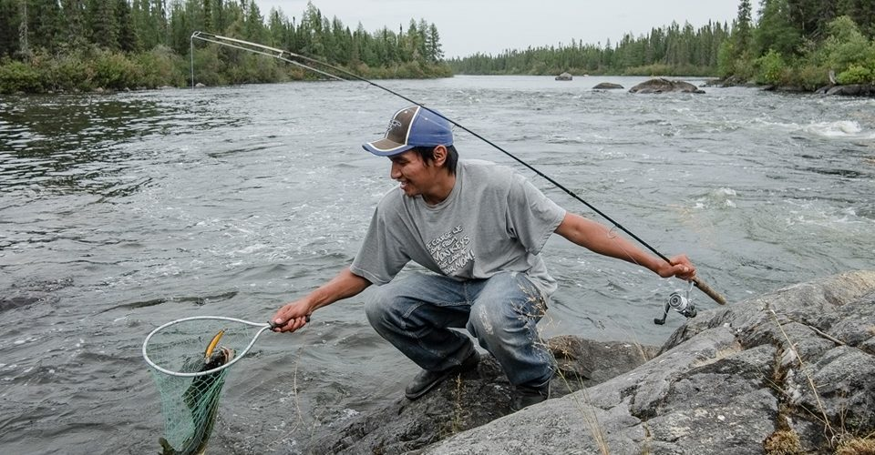 Orion McKay catches some pickerel for dinner on the Fawn River