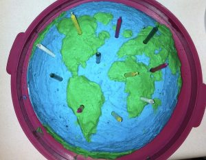 Earth Day birthday cake. A\J Alternatives Journal.