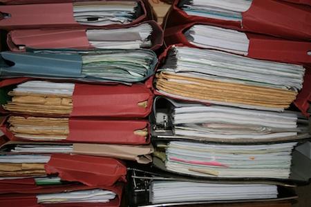 Piles of files. Editorial intern. Alternatives Journal.