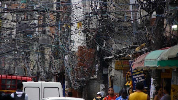 Electric wires in a slum in Brazil in a scene from PANDORA'S PROMISE. Photo credit: Robert Stone