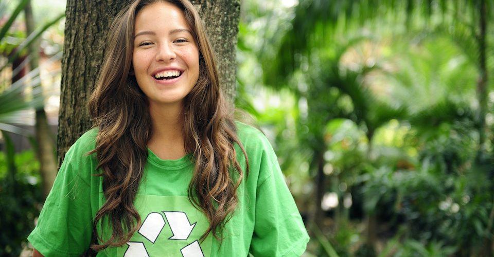 Girl in green recycle logo shirt A\J AlternativesJournal.ca