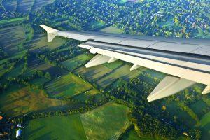 Airplane over Field Pickering A\J AlternativesJournal.ca
