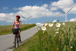 biking in denmark by windmills A\J AlternativesJournal.ca