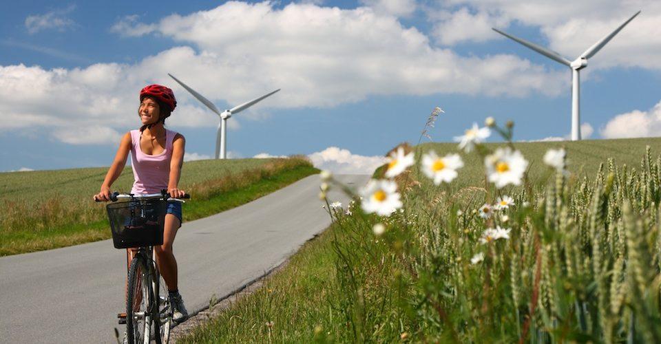 biking in denmark by windmills A\J AlternativesJournal.ca