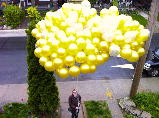 Leahjane Robinson with 300 balloons, used for a protest at Hudbay's shareholder meeting.