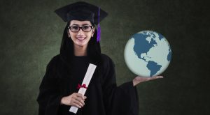 Graduating student holds the planet in her hands.