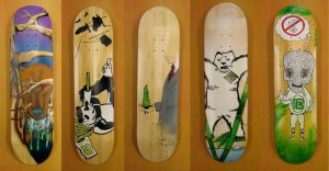 Skateboards designed by students in the Oasis Skateboard Factory.