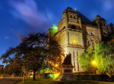 Queen's Park, Ontario parliament building at night.