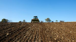 Tractor sowing seeds on a field.