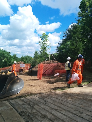 Enbridge construction workers leaving the site shortly after protesters arrived.