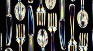 Knives, forks, and spoons made from a biodegradable starch-polyester material.