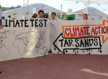 Activists with signs at COP20