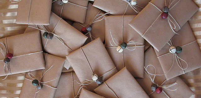Packages in brown paper with string and bells.