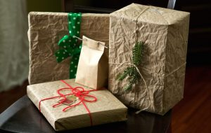 Brown paper packages tied up with string by Susy Morris