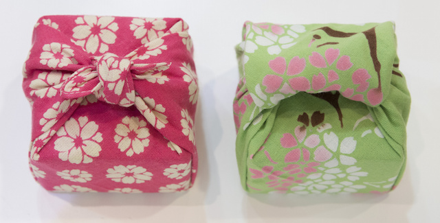 Gifts wrapped in fabric.