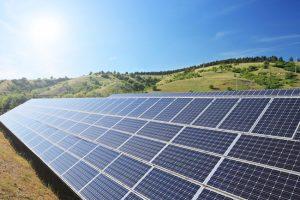 Solar panels on a hill.
