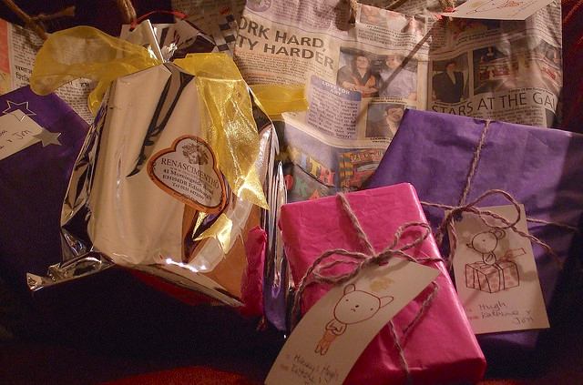 Presents wrapped in tissue and newspaper.