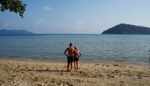 (Photo: a couple stands on a beach in Thailand)