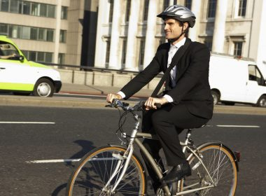 (Photo: a businessman riding a bicycle to work)