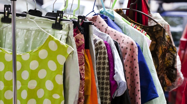 (Photo: a rack of used clothing)