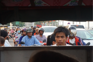 The view from a back window of a tuk-tuk in Phnom Penh