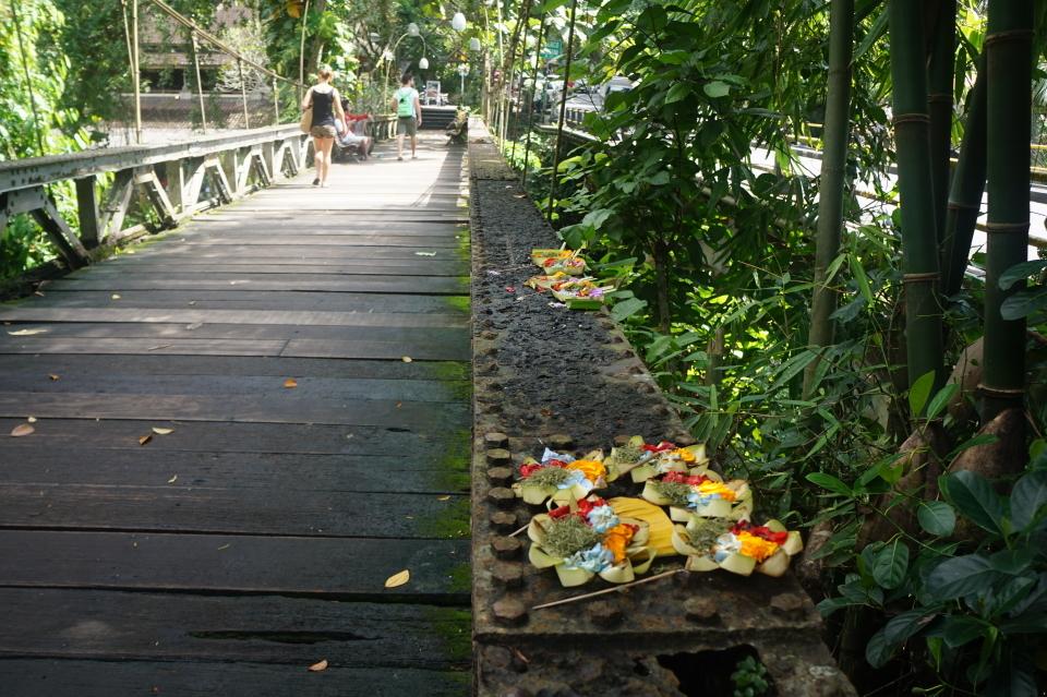Offerings on a rusty bridge in Ubud, Bali