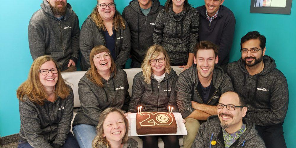 Camino staff with 20th birthday cake