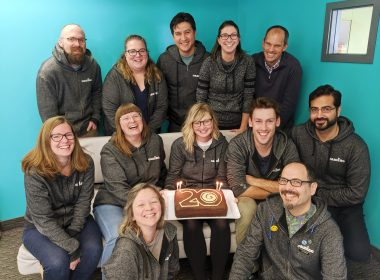 Camino staff with 20th birthday cake